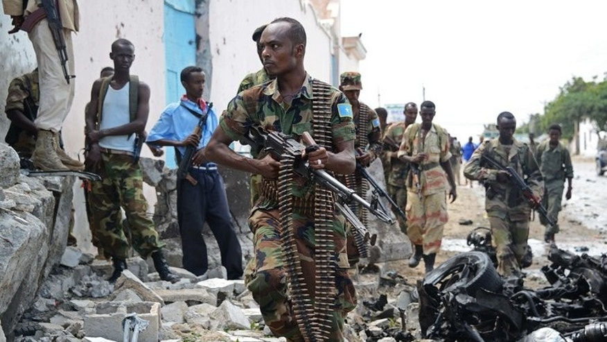 Somali National Government (SNG) soldiers are pictured after Al-Qaeda linked Shebab insurgents shot and blasted their way into the United Nations (UN) compound in Mogadishu on June 19, 2013. At least one person was killed Saturday when a car bomb exploded in Somalia's capital, the latest in a string of attacks, a local official said.