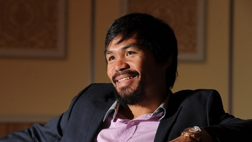 Manny Pacquiao during an AFP interview in Macau on July 27, 2013. The Philippine great is harbouring thoughts of running for president in his beloved homeland when he finally hangs up his gloves, he revealed to AFP in an exclusive interview.