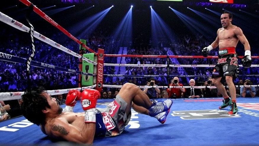 Manny Pacquiao falls to the canvas after being knocked down by Juan Manuel Marquez on December 8, 2012 in Las Vegas. Marquez caught him with a huge right hand that saw the Filipino crumple to the canvas -- his second successive defeat.