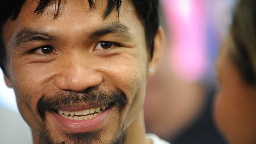 Manny Pacquiao, pictured in Hollywood, California, on October 26, 2011. Philippine boxing legend will strap on his gloves on a Sunday morning when he takes on Brandon Rios in Macau on November 24, as promoters cash in on the lucrative US pay-per-view market.