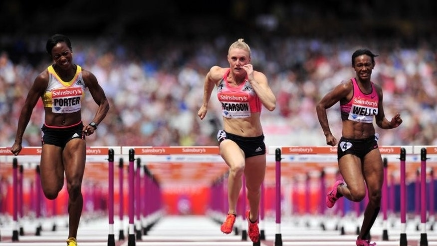 Tiffany Porter of Great Britain (left) Sally Pearson of Australia (centre) and Kellie Wells of the US compete in the womens 100 metres hurdles event during the London Anniversary Games International Association of Athletics Federations (IAAF) Diamond League International Athletics championships at the Olympic Stadium in London on July 27, 2013. Pearson posted her best time of the season.