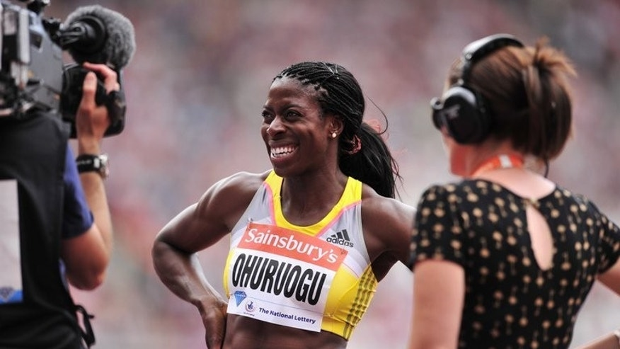 Christine Ohurogu of Great Britain smiles after winning in the womens 400 metres event during the London Anniversary Games International Association of Athletics Federations (IAAF) Diamond League International Athletics championships at the Olympic Stadium in London on July 27, 2013.