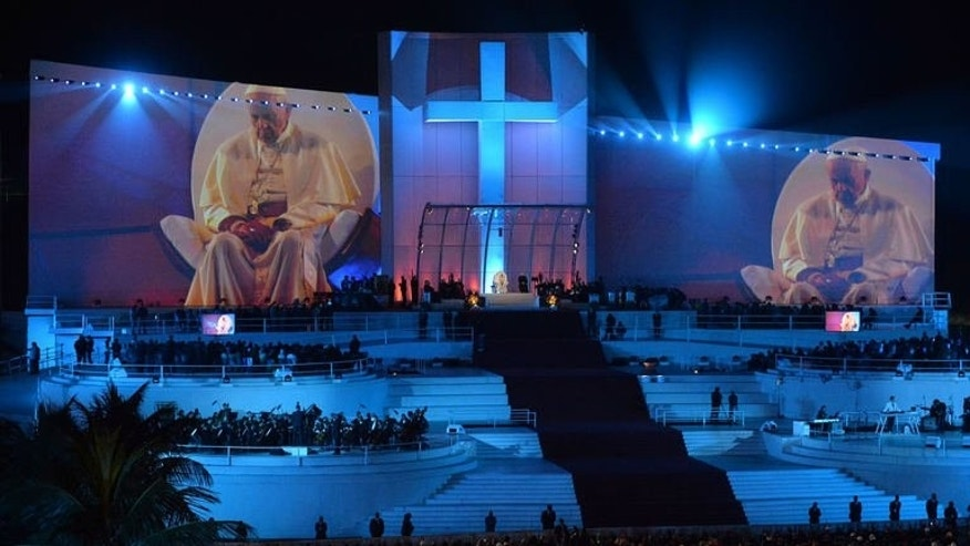 Pope Francis watches the re-enactment of the Stations of the Cross on Copacabana beach in Rio de Janeiro, on July 26, 2013. The pope took his mission to re-energize his flock to legions of young Catholics on a Brazilian beach Friday, reaching out those who have lost faith due to church failings.