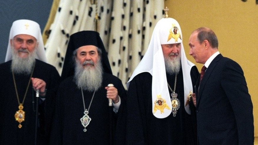 Vladimir Putin (right) with Patriarch Kirill (2nd right) and other Orthodox leaders in the Kremlin on Thursday. The Russian President arrived in Kiev on Saturday for politically charged festivities celebrating the arrival of Christianity in Russia and Ukraine, highlighting a tug-of-war over Kiev's moves to integrate with the EU.