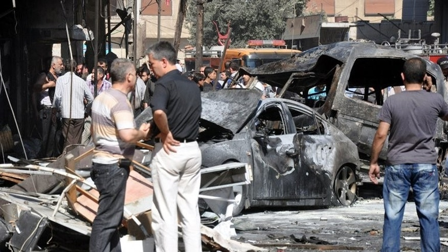 "Burned-out cars after an attack that killed at least 17 people on Thursday in Jaramana suburb in Damascus. Syria's main opposition group wanted to talk about their ""desperate"" need for weapons, but Western leaders they met this week preferred to discuss floundering hopes for a peace conference."