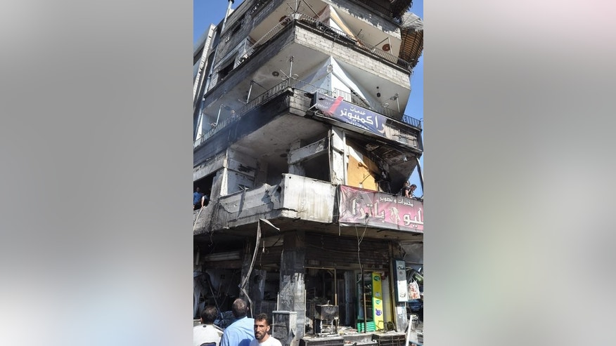 A building in Jaramana suburb in Damascus on Thursday after a car bomb attack that killed at least 17 people. The diplomatic dance around the Syrian National Coalition tour this week just confirmed that President Bashar al-Assad and his rebel opponents are nowhere near ready to thrash out a peace deal, according to diplomats and experts.
