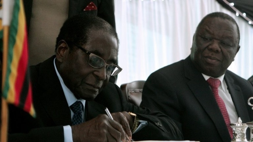 Zimbabwe's President Robert Mugabe (left) signs into law Zimbabwe's new constitution next to Prime Minister Morgan Tsvangirai at the State House in Harare, on May 22, 2013. When Zimbabweans go to the polls next week to choose between veteran President Robert Mugabe and long-time rival Morgan Tsvangirai, it is young and rural voters who may decide the victor.