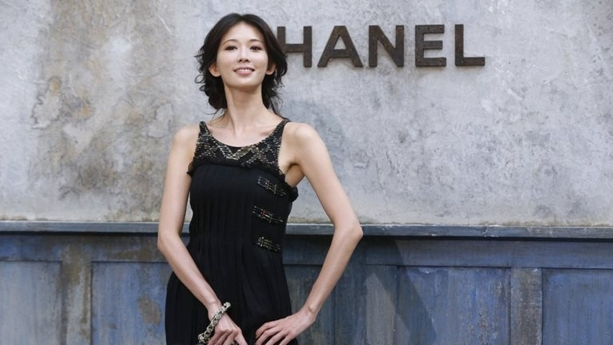 Taiwanese actress and model Lin Chi-ling, pictured during a photocall prior to the Chanel Haute Couture Fall-Winter 2013/2014 collection shows, at the Grand Palais in Paris, on July 2, 2013. Lin is one of an elite group of bankable Asian names attracting the attention of the fashion world.