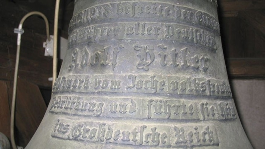 This Oct. 21, 2004 photo shows a bell with Adolf Hitler's name on it in the castle of Wolfpassing, Austria. (AP Photo)