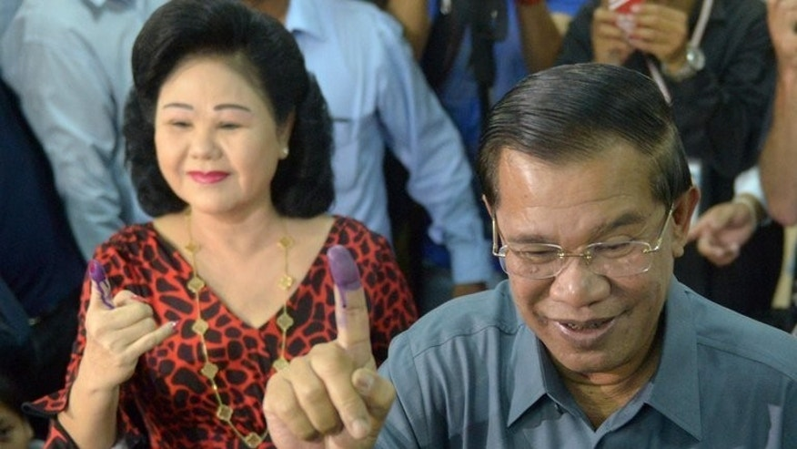 Cambodian Prime Minister Hun Sen and his wife Bun Rany cast their votes in Kandal province, on Sunday. Hun sen's party claimed victory in Sunday's elections which were marred by allegations of widespread irregularities, but it faced rare competition from a resurgent opposition