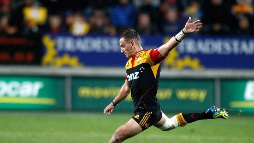 Aaron Cruden of the Waikato Chiefs kicks the ball during a Super 15 rugby union match in Hamilton, on July 27, 2012. The Chiefs will defend their league title against Australia's ACT Brumbies in New Zealand after tense semi-final victories this weekend. The Chiefs surged home with a 17-point burst in the second-half to down seven-time champions Canterbury Crusaders, 20-19.