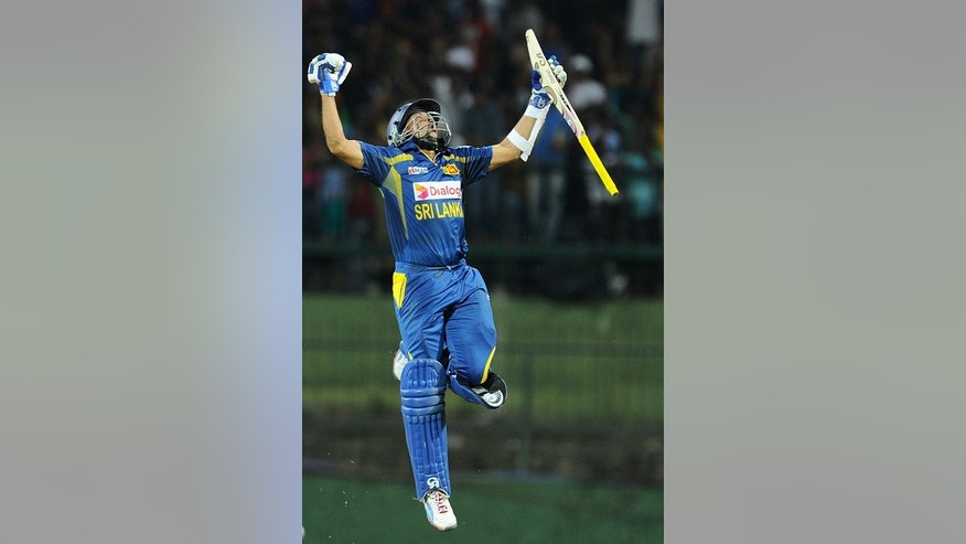 Sri Lankan cricketer Tillakaratne Dilshan celebrates after winning the fourth One Day International (ODI) cricket match between Sri Lanka and South Africa in Pallekele on July 28, 2013.
