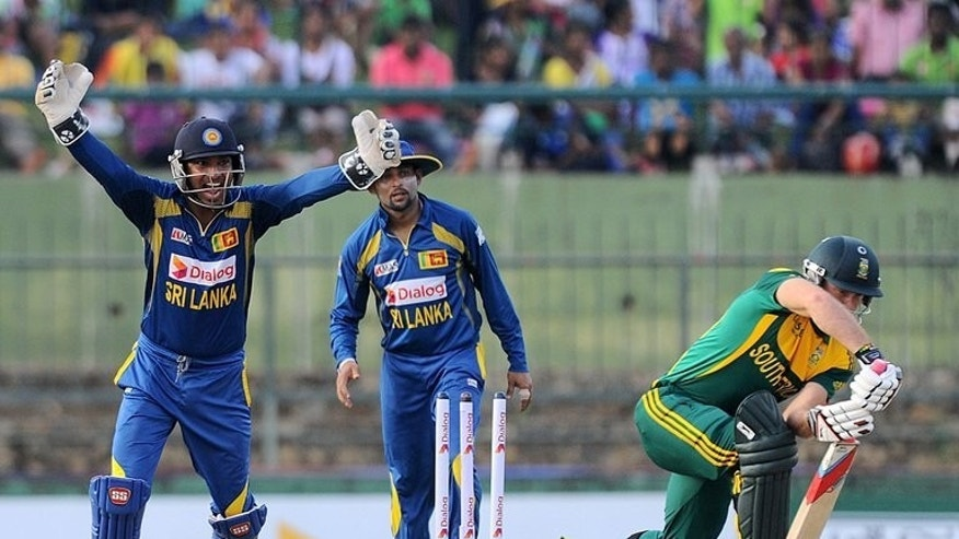 Sri Lankan wicketkeeper Kumar Sangakkara celebrates the wicket of South African cricketer David Miller, in Pallekele on July 28, 2013. Sri Lanka defeated South Africa by eight wickets in the fourth one-day international to take an unbeatable 3-1 lead in the five-match series.