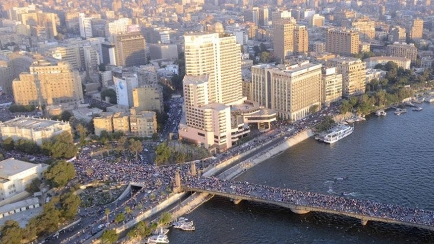 A Egyptian army picture shows people crossing the Nile River to Cairo's Tahrir Square on Friday. EU foreign policy chief Catherine Ashton flew into Egypt for talks Monday as international pressure increased on the new regime over the weekend's violence, which claimed more than 80 lives.