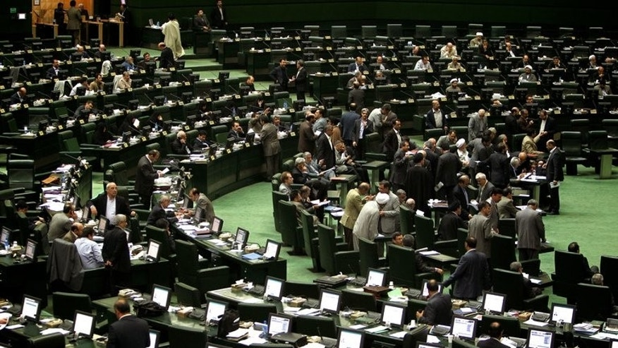 Iranian MPs attend a parliament session in Tehran. Conservative lawmaker Ali Motahari on Sunday called for the release of political prisoners in Iran and questioned the ongoing house arrests of opposition leaders Mir Hossein Mousavi and Mehdi Karroubi.