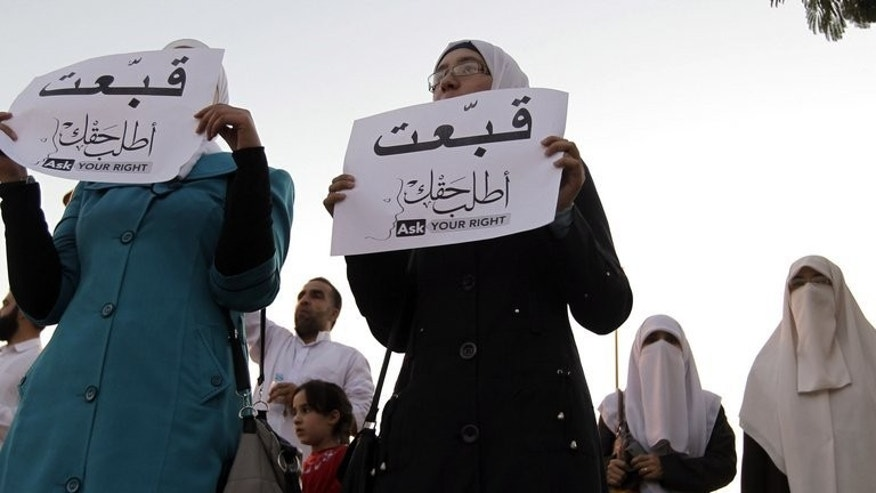 Women demonstrate in Amman on June 13 against a proposed rise in the price of electricity. Jordan plans to raise power prices after doubling taxes on cellphones to offset a large budget deficit, despite warnings that such measures will provoke a public outcry.