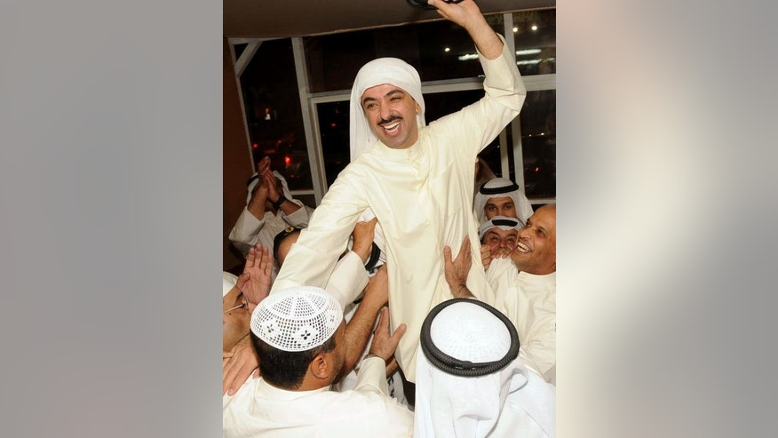 Former parliament speaker Ali Al-Rashed celebrates with supporters following parliamentary elections, in Kuwait City, on July 28, 2013. There was a significant rise in voter turnout on the previous election, the result of which was controversially scrapped in a court ruling last month.