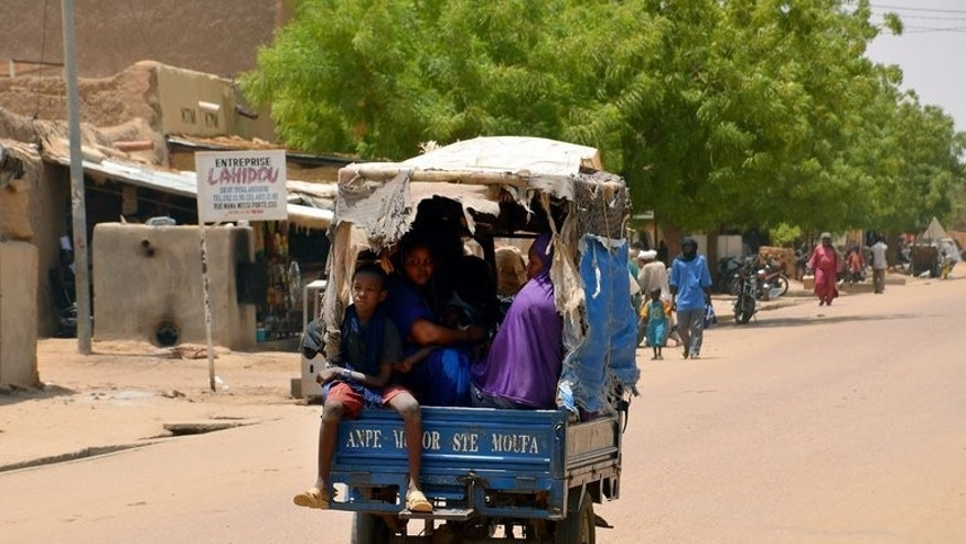 People travel in a collectif taxi in Gao on July 25, 2013. Malians voted Sunday for a president expected to usher in a new dawn of peace and stability in the conflict-scarred nation.