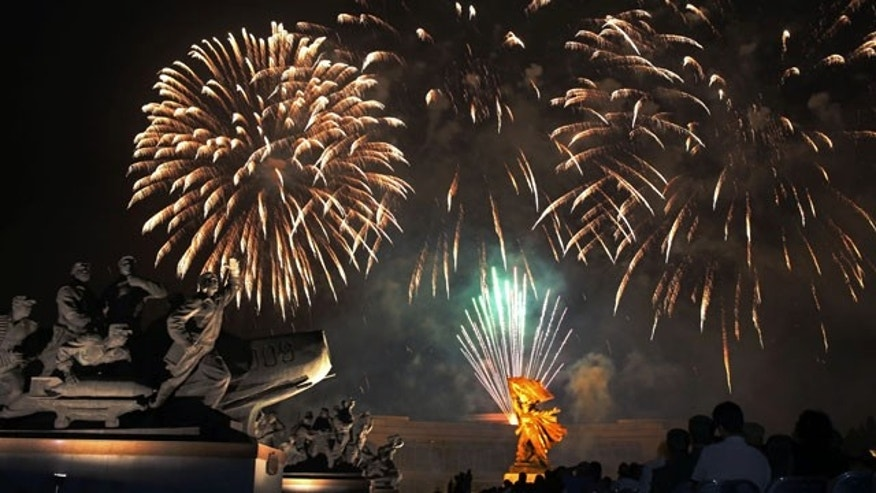 July 27, 2013: Fireworks explode behind the Fatherland Liberation War Museum as part of the celebrations for the 60th anniversary of the Korean War armistice, in Pyongyang, North Korea. (AP Photo)