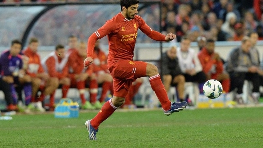 Liverpool's Luis Suarez in Melbourne on July 24, 2013. Former Liverpool striker Michael Owen says he would be surprised if Anfield favourite Luis Suarez leaves to join English Premier League rivals Arsenal.