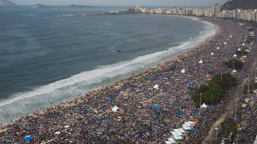 People pack Copacabana beach in Rio de Janeiro, Brazil, Sunday, July 28, 2013. Hundreds of thousands of young people slept under chilly skies in the white sand awaiting Pope Francisâ final Mass for World Youth Day. (AP Photo/Felipe Dana)