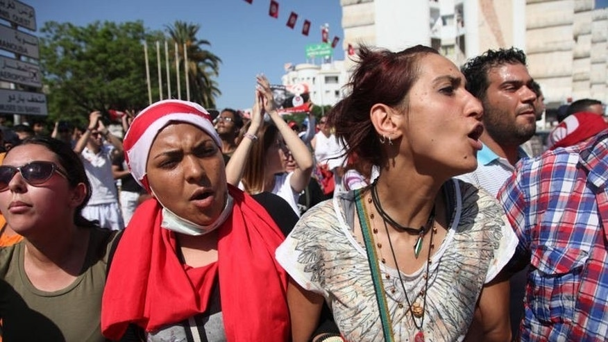 Protesters shout slogans against the ruling Islamist party in front of the National Assembly in Tunis on July 27, 2013. Mohamed Brahmi's cold-blooded murder on Thursday outside his home has stoked tensions in the North African nation where the Arab Spring began.