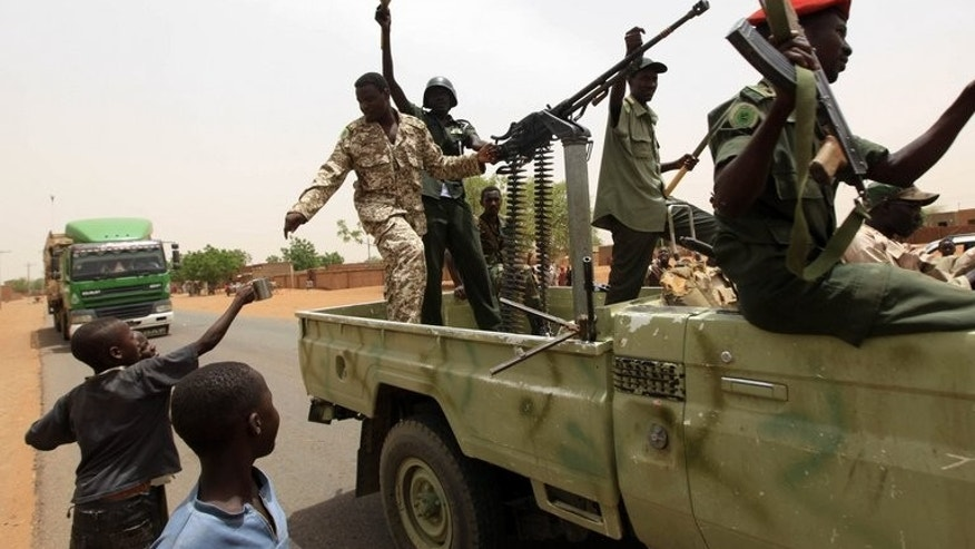 Sudanese forces celebrate after reportedly regaining control of the district of Abu Kershola on May 28, 2013. Sudan's military spokesman is ready to battle a Facebook imposter who has been making online comments about the country's armed forces, official media say.