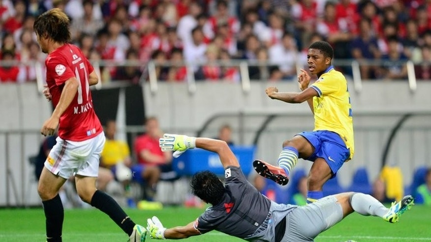 Young Arsenal forward Chuba Akpom scores the winner in a 2-1 victory over Urawa Reds on July 26, 2013. The Gunners won all four of their Asian tour matches, although they struggled in the final match against J-League side Urawa.
