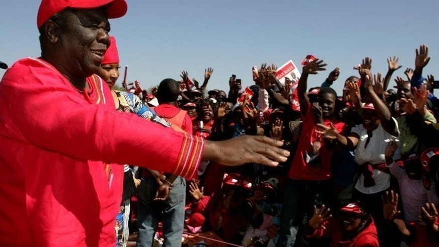 Zimbabwe PM Morgan Tsvangirai addresses an election campaign rally at Mkoba Stadium in Gweru on July 21, 2013. Zimbabwean police on Sunday arrested an aide to Morgan Tsvangirai, President Robert Mugabe's main rival in upcoming polls, after he reported an irregularity in early voting.
