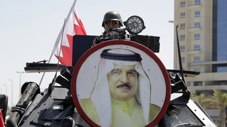 "A portrait of Bahraini King Hamad bin Issa al-Khalifa hangs on a tank as armed forces secure Manama's Pearl Square on March 19, 2011. Bahrain's King Hamad ordered the government on Monday to implement a parliamentary call for tough measures against what the authorities are calling an upsurge in ""terrorism"" linked to Shiite-led protests."