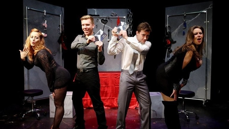 """Actors rehearse """"Cuff Me: The Fifty Shades of Grey Musical Parody"""" at Actors Temple Theatre, New York. The Londo Fire Brigade urges those using handcuffs in the bedroom to """"always keep the keys handy""""."""