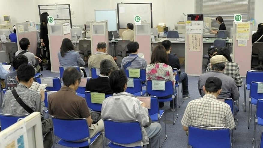 Job seekers await for an interview at the employment exchange office in Tokyo on May 28, 2010. Japan's jobless rate fell to 3.9 percent in June, dropping to the lowest point in more than four years, a government survey showed.