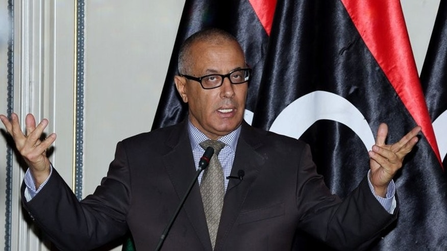 Libyan Prime Minister Ali Zeidan speaks during a press conference in the capital Tripoli on July 29, 2013. Zeidan said he would carry out a reshuffle of his government in the coming days, a move aimed at ending the country's current political crisis.