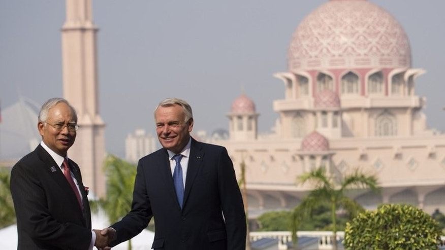 "Jean-Marc Ayrault (right) meets Malaysian counterpart Najib Razak in Putrajaya on Monday. The French Prime Minister declared elections in Mali a ""great success"" for France, which sent troops to the African nation this year to dislodge Islamist groups."
