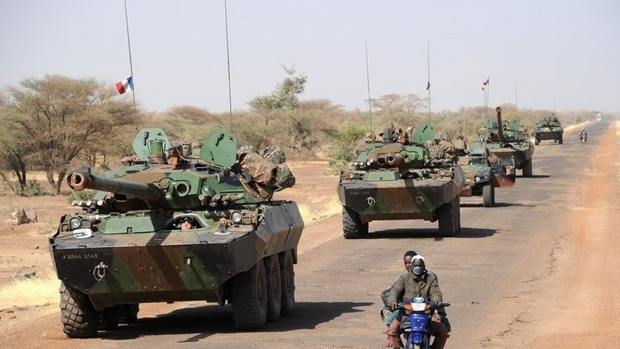 A convoy of French army vehicules heads towards Gao in Mali in February. Mali voted on Sunday for a new president in the first election since a military coup in March 2012 helped plunge the country into chaos.