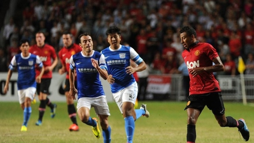 Jesse Lingard on the ball against Kitchee at Hong Kong stadium on Monday. Lingard put the gloss on a satisfactory evening for United with a lovely curled shot with 10 minutes left.