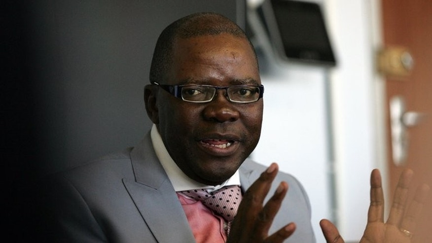 Tendai Biti delivers his midterm state of the economy address in Harare last week. Zimabwe's finance minister complained on Monday that President Robert Mugabe's rivals have not yet received a copy of the electoral roll, just two days before the presidential election.