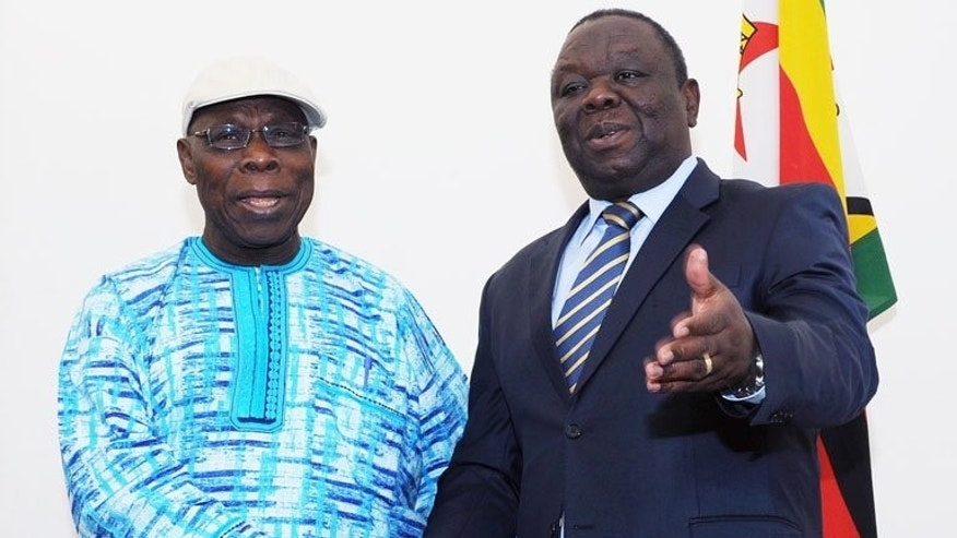 Morgan Tsvangirai (right) with African Union Observer Mission chair Olusegun Obasanjo in Harare on Monday. Robert Mugabe on Sunday warned MDC presidential candidate Tsvangirai against announcing results before the official count.