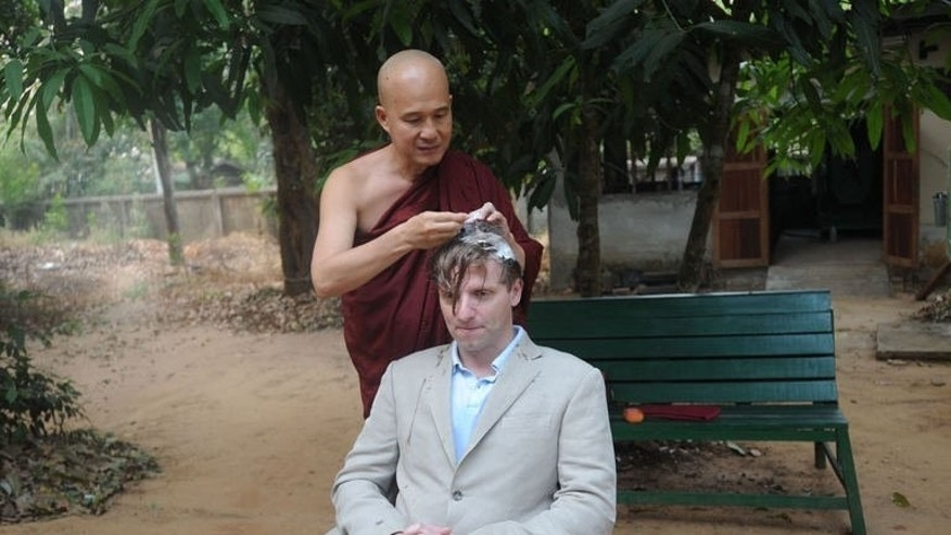 "British art historian, Rupert Arrowsmith, has his hair shaved before he enters monastic life on the outskirts of Yangon, on February 23, 2013. Arrowsmith spent 45 days of total silence in the ""famously austere"" Chanmyay Yeiktha monastery, a peaceful compound of rooms for meditation and sleeping."