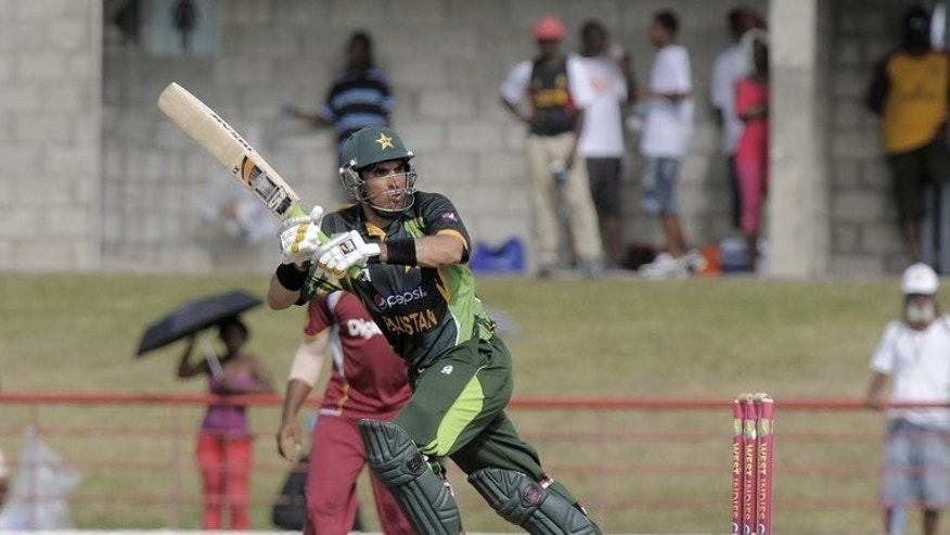 "Pakistan captain Misbah-ul-Haq plays a shot against West Indies during the ODI series at Beausejour Cricket Ground, St. Lucia on July 24, 2013. Pakistan's cricket chief termed fixing allegations over the team's one-day series against the West Indies as ""outrageous"" adding his board had insisted on a full investigation by the International Cricket Council (ICC)."