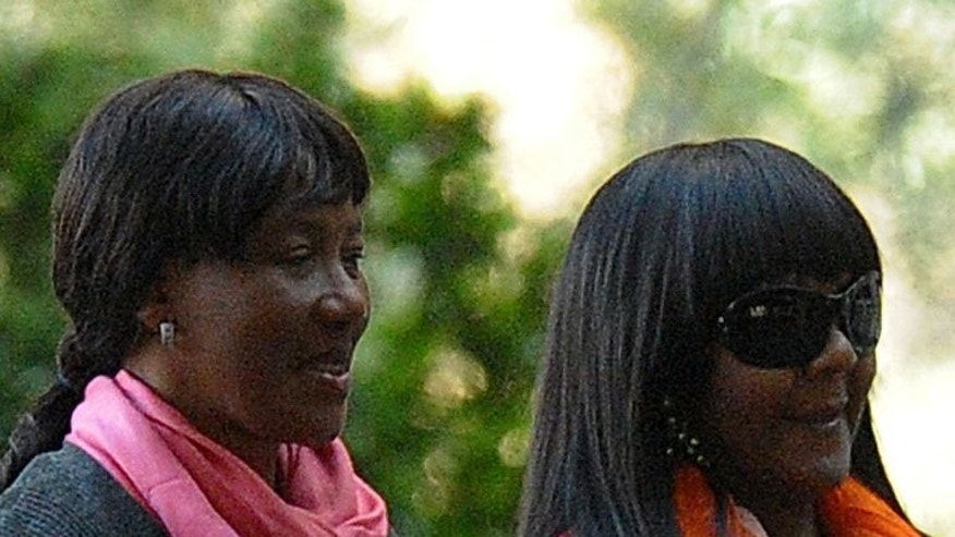 Makaziwe Mandela (left) and Nelson Mandela's grand-daughter Ndileka visit him in hospital in Pretoria on July 12. A South African judge postponed a court battle over control of Nelson Mandela's companies Monday, after a lawyer for his daughters withdrew from the case.