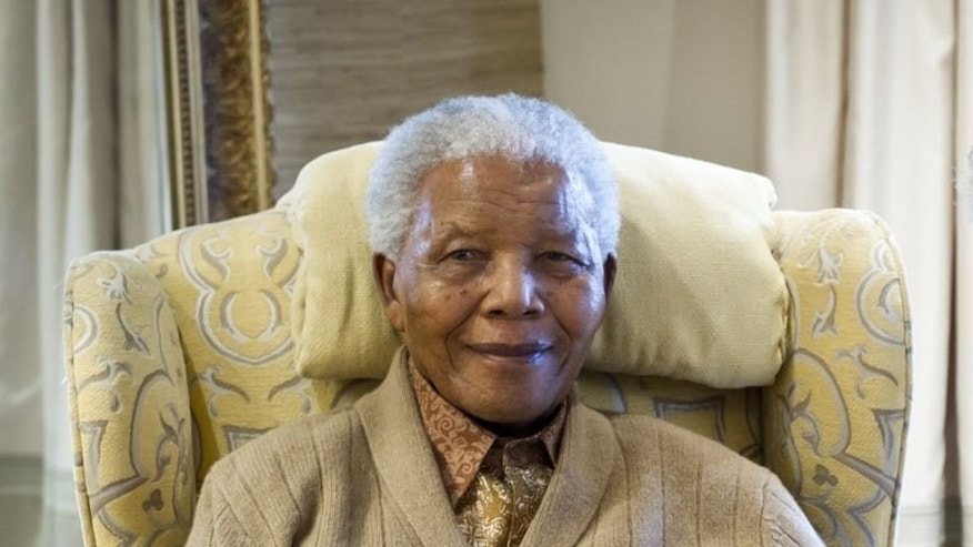 Nelson Mandela in July last year at his home in Qunu, Eastern Cape. South Africa's presidency said that Nelson Mandela is still critically ill in hospital but improving slightly, declining to comment on a report the anti-apartheid hero had undergone an operation.