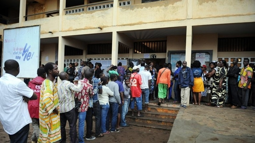 People queue at a polling station in Lome last Thursday. The main opposition coalition, Let's Save Togo, had alleged irregularities even before full results in Togo's parliamentary elections were announced by the electoral commission on Sunday night.