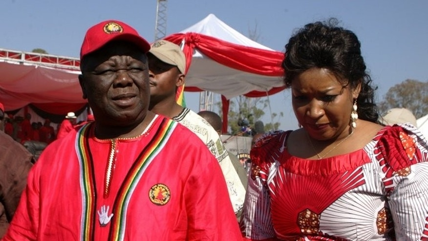 Morgan Tsvangirai and his wife Elizabeth arrive on July 7, 2013 for the launch of his election campaign in Marondera. This Wednesday Tsvangirai will get his third crack at dethroning veteran Zimbabwean leader Robert Mugabe - and it may be his last.