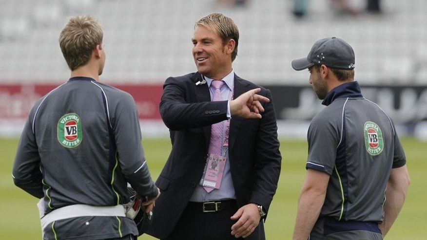 Australian former cricketer Shane Warne (C) talks to Steven Smith (L) and Phillip Hughes at the Ashes cricket test match between England and Australia at Lord's cricket ground London, on July 21, 2013. Australia are to call on Warne to advise their spinners ahead of the make-or-break third Ashes Test at Old Trafford -- where the leg-spin legend delivered the 'ball of the century' 20 years ago.