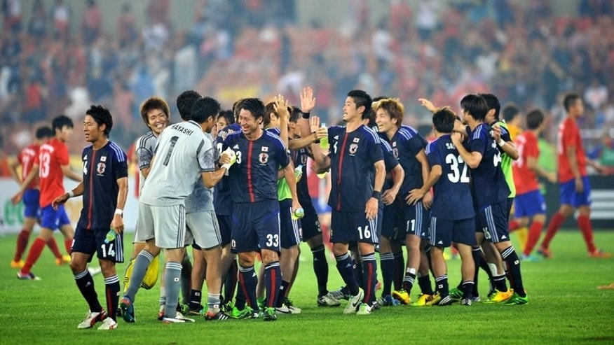 Japan players celebrate their victory against South Korea in Seoul on July 28, 2013. Political banners and a military flag displayed during the match have dragged top government officials from both countries into a diplomatic spat.