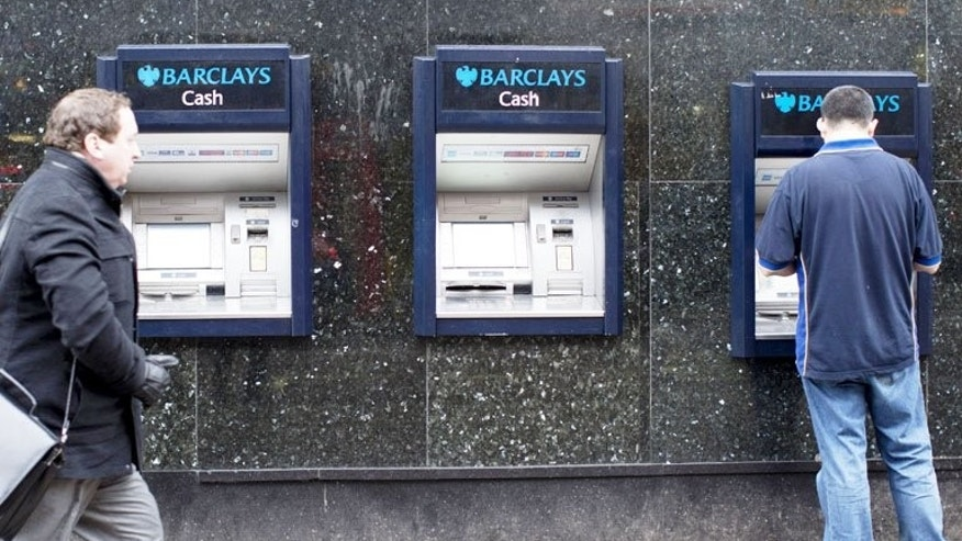 Barclays cash machines in London. Barclays set out on Tuesday to raise ??5.8 billion by offering shares at a massive discount to shareholders so as to fall into line with demands from regulators.