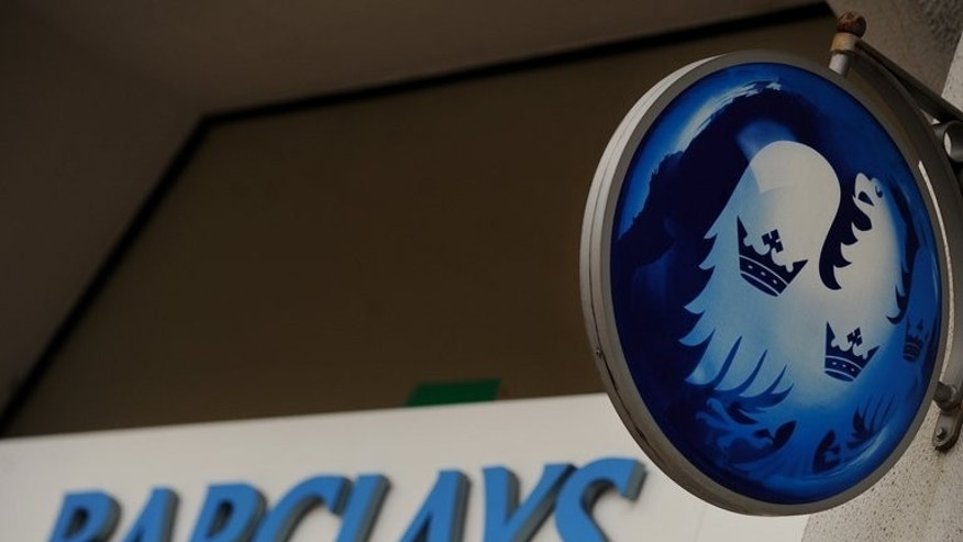British bank Barclays on Tuesday launched plans to raise ??5.8 billion ($8.9 billion, 6.7 billion euros) via a shares sale to bolster capital levels, but revealed that first-half profits more than quadrupled.