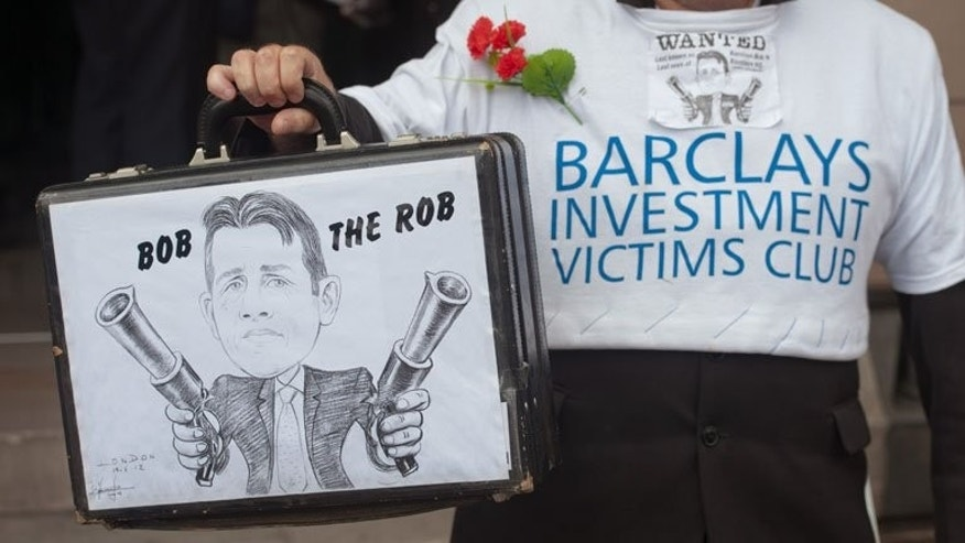 A protest in London last July against former Barclays chief executive Bob Diamond. Barclays reported first-half results which showed a quadrupling of net profit, but the scale and terms of the proposed rights issue drove the price of the shares down by as much as 7 percent.
