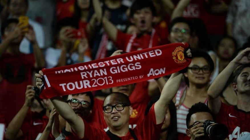 Fans of Manchester United cheer before the start of a match against Hong Kong on July 29, 2013. The Premier League's top sides went on money-spinning tours of Asia this month that saw them take in a total of six countries or territories. But there was one glaring omission: mainland China.